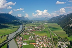 drone shot of Rattenberg city with river Inn
