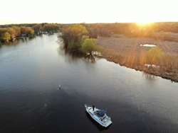 Drone shots of a flooded river and lake. Taken during sunset and mid day for some diversity.