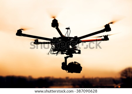 Drone. Silhouette against the sunset sky.