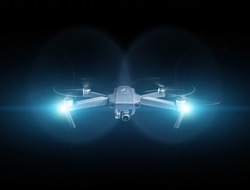 Drone spy. Drone - Flying in the dark, on black background. Closeup on dark. Portable drones, View on the drones gimbal and camera.