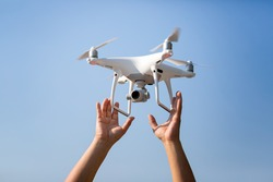 Drone start flying take off to the beautiful sky