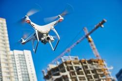 drone survellance over construction area. building site inspection.