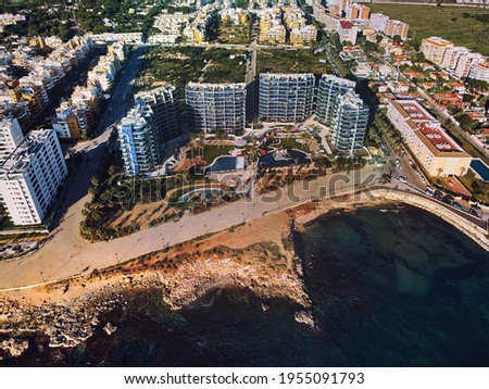 Drone top point of view Punta Prima seaside with rocky coastline and modern residential building complex at sunny summer day.  Travel and tourism of Spain concept. Province of Alicante, Costa Blanca Stockfoto ©