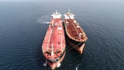 drone view during ship to ship  transfer operation between oil tankers
