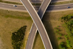 Drone view of highway and 2 bridges shaped like x.