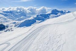 Drone view of mountain ski slopes.