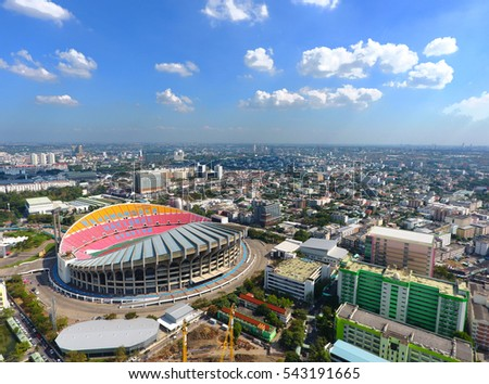 Drone view of the Rajamangala national stadium with cloudy sky.