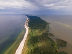 Drone view of whole curonian spit in sunny day, spit between sea and gulf