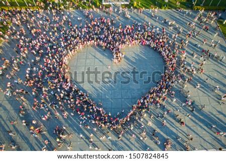 Drone view of women who formed a huge heart shape in the main square of Izmir. International Fancy Women Bike Ride Tour.