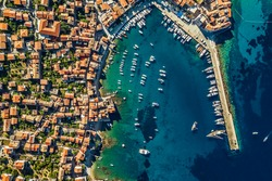Drone View on a Beach Bay. Aerial View of a Coastal City with Red Roofs near Yacht Harbor. Luxury Summer Vacation in Dubrovnik. Croatia.