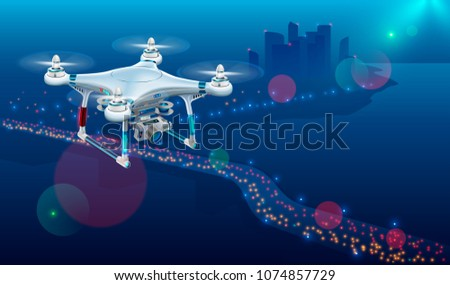 Drone with video camera In The Air Over City Roadway. Unmanned Aircraft System or UAV monitoring street traffic or photography urban landscape in the Night .