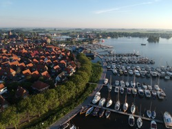 Dronephoto from the small Dutch village of Grou. in the provence of Friesland. This town is famous for watersports, sailing, and traditional boats.