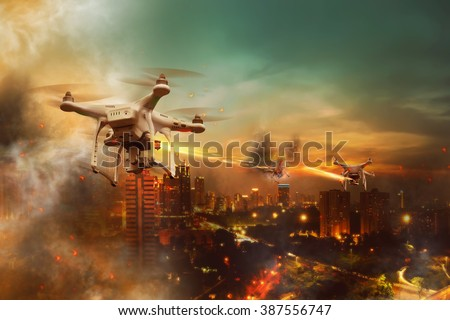 Drones battle over the city at night time