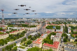 Drones fly over a residential city. Urban landscape with drones flying over it, quadrocopters.