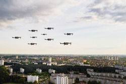 Drones fly over the city's houses. Urban landscape with drones flying over it,  flying over the city.