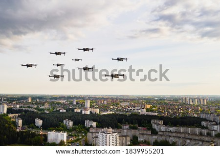 Drones fly over the city's houses. Urban landscape with drones flying over it,  flying over the city. Stock photo ©