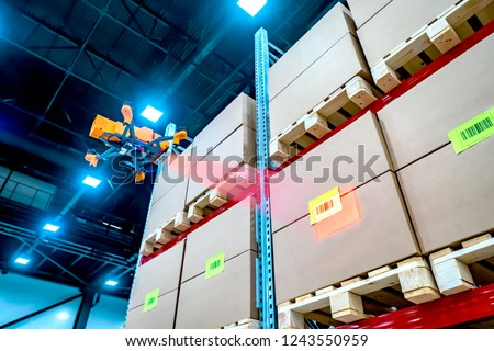 Drones scans barcode. Modern warehouse. Inventory in stock. Drone reads the barcode boxes in stock. Automation. Storage management. Responsible storage. Warehouse inspection.