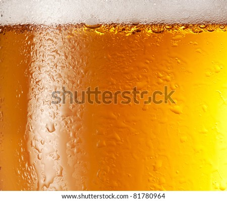 Drop and foam of beer as background.