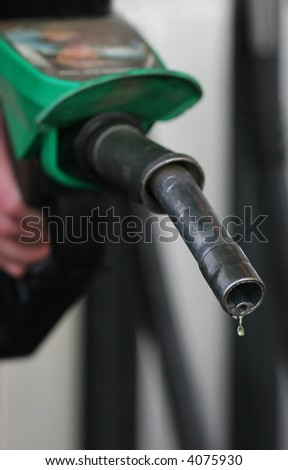 Drop fuel drips at the petrol station