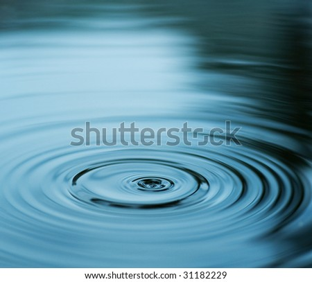 Droplet falling in blue water