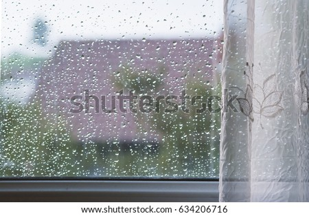 Droplets on the windows glass after rainy summer day #634206716