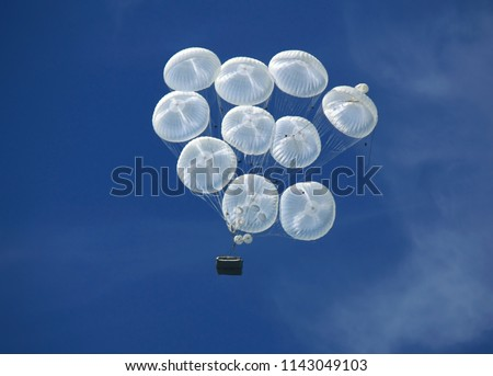 Dropping airborne combat vehicle  using military parachute system