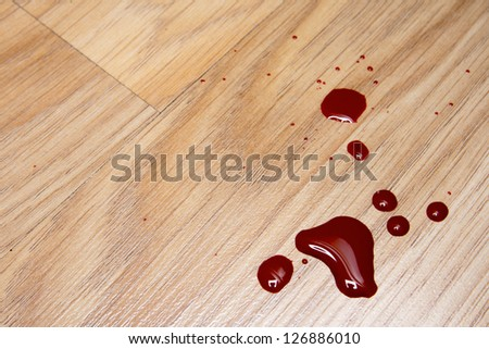 Drops of blood on laminate floor texture