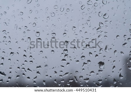 Drops of rain on a window pane #449510431
