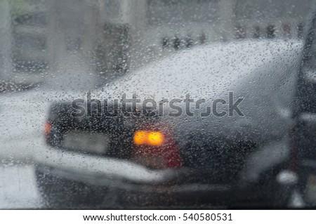 Drops of rain on a window pane #540580531