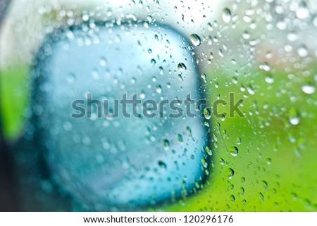 drops of rain on glass of car