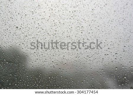 Drops of rain on the inclined window (glass). Shallow DOF #304177454