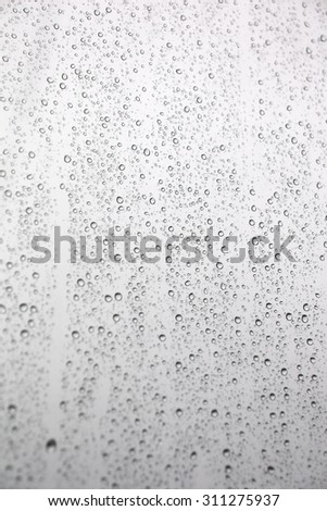 Drops of rain on the inclined window (glass). Shallow DOF #311275937