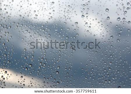 Drops of rain on the window (glass). Shallow DOF. #357759611