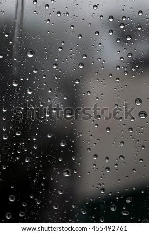 Drops of rain on the window, rainy day, dark tone. Shallow DOF #455492761