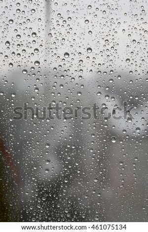 Drops of rain on the window, rainy day. Shallow DOF #461075134