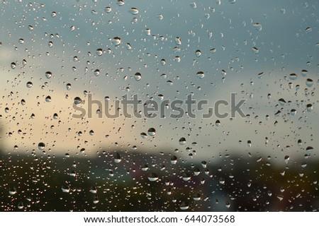 Drops of rain on the window, rainy day. Shallow DOF #644073568