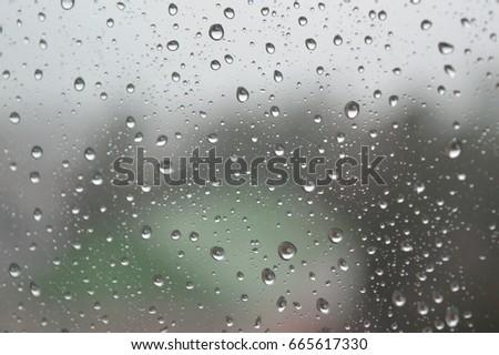 Drops of rain on the window, rainy day. Shallow DOF #665617330