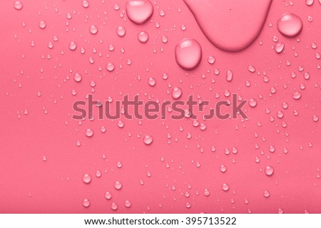 Drops of water on a color background. Pink. Toned.