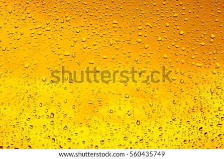 Drops of water on a glass of beer. Background, Texture #560435749