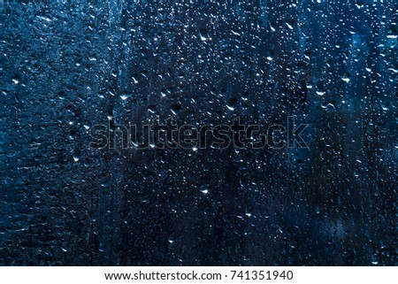 drops of water on the glass, rain behind the kon, background