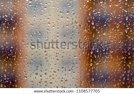 Drops of water on the window glass after rain. Abstract texture with shalow depth of field.