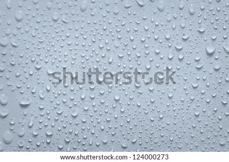 drops of water on wet white surface - stock photo