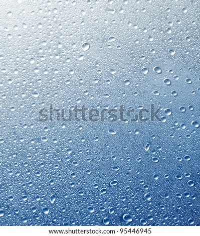 Drops on a glass surface with a blue color gradient background