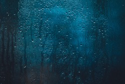 drops on glass , window condensation , and the background for dark text , spray on the window