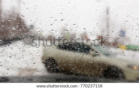 Drops on the car window in winter #770237158