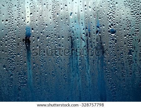 drops on the glass ,rain, the rain outside the window,