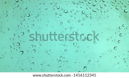 Drops. Water drops. Drops of water on the glass. Wet surface. Abstract background. Splashed glass #1456112345