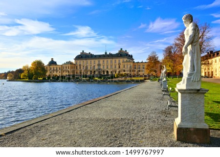 Drottningholm Palace, Sweden's royal residence along its statue lined lake during autumn #1499767997