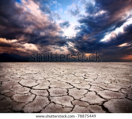 drought earth and storm dramatic sky at background
