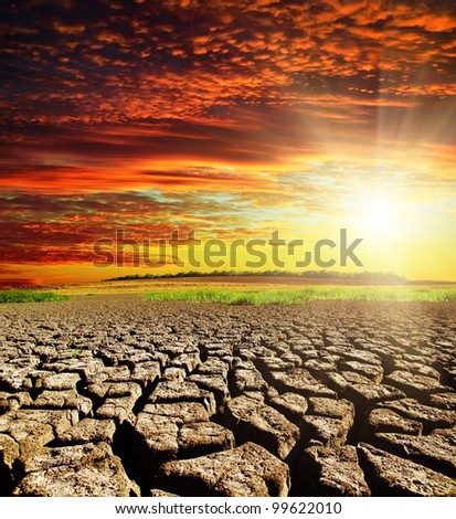 drought earth with red clouds and sunset